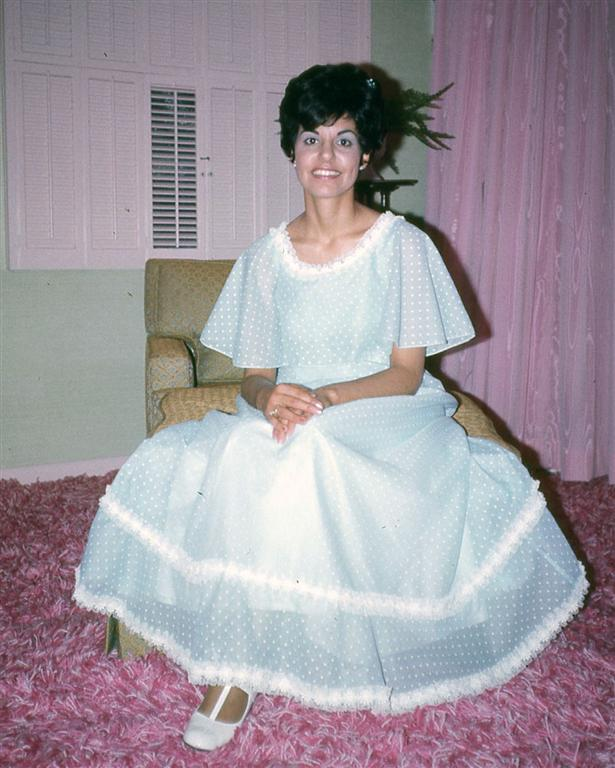 Frances sitting on a chair in her wedding dress