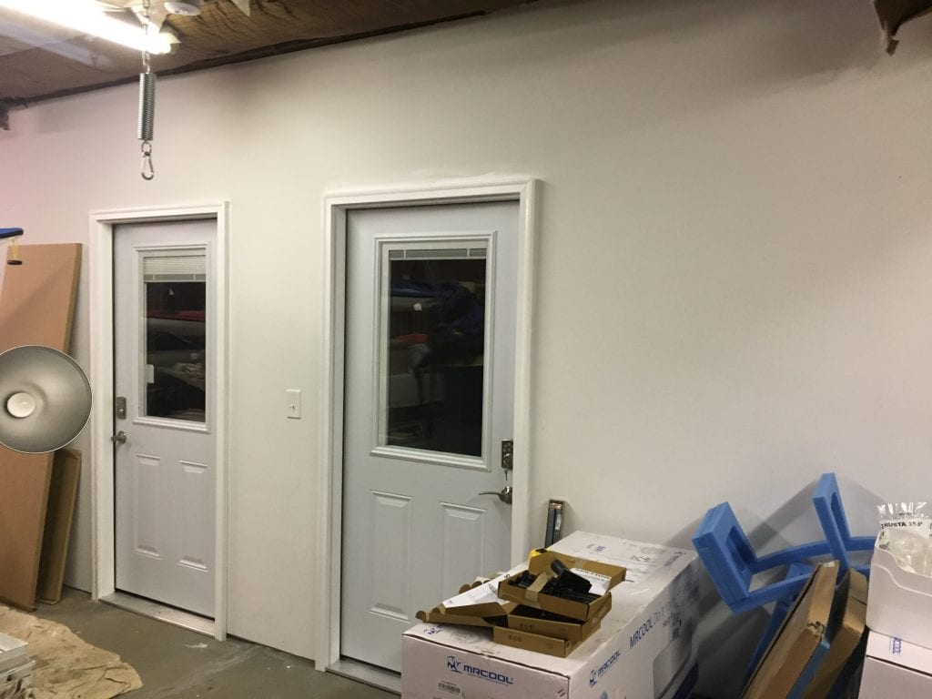 Wall of office showing two doors